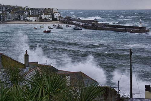 Worst storm is St Ives for 30 years as waves break over tops of houses